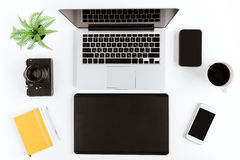 Flat lay with various wireless devices and coffee cup. On modern workplace Stock Photos