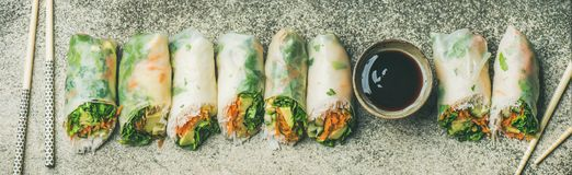 Flat-lay of vegan spring, summer rice paper rolls, wide composition. Helathy Asian cuisine. Flat-lay of vegan spring, summer rice paper rolls with vegetables Stock Photo