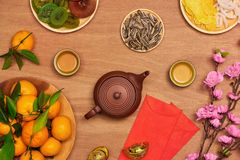 Flat lay Vietnamese new year food and drink on rustic red wooden table top. Text appear in image: Prosperity. Flat lay Vietnamese new year food and drink on royalty free stock images