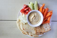 Flat lay view of homemade hummus. With assorted fresh vegetables and pita bread.Copy space Royalty Free Stock Photos