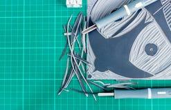 Flat lay view of lino cutting tools. Lino cutting tools on a desktop. Lino cut tools and lino block Royalty Free Stock Image