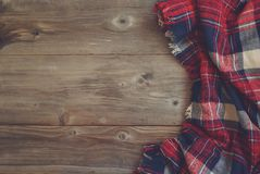 Flat Lay View Of Tartan Textured Scarf On Wooden Background With Space For Your Text Or Product Stock Photo