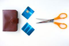 Flat lay view of a  pair of scissors with a cut credit cared and. A wallet. Finance problems concept. Real people. Copy space Royalty Free Stock Photos