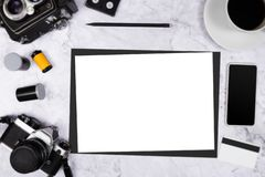 Flat lay vintage camera on white marble background with white blank paper and photography tool stock photos