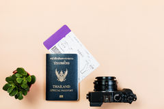 Flat lay  of vintage digital compact camera with Thailand official passport, boarding pass, and small cactus. Flat lay and copy space for design work of vintage Royalty Free Stock Image