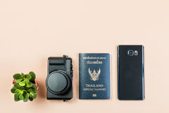 Flat lay of vintage digital compact camera with Thailand official passport and smart phone and small cactus. Flat lay and copy space for design work of vintage royalty free stock photo