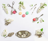 Flat lay white lilac flowers macaroon cakes Sweet food Royalty Free Stock Photography