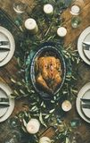 Flat-lay of whole roasted chicken for Christmas over table background Stock Photography