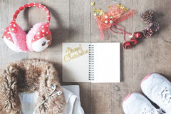 Flat lay of winter fashion  items, empty notebook and Christmas Royalty Free Stock Images