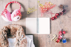 Flat lay of winter items, empty notebook and Christmas decoratio Royalty Free Stock Image