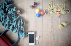 Flat lay of winter scraft, Christmas decoration items and smartp Stock Images