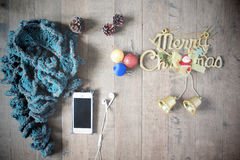 Flat lay of winter scraft, Christmas decoration items and smartp Royalty Free Stock Images