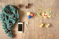 Flat lay of winter scraft, Christmas decoration items and smartp Stock Image