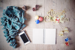 Flat lay of winter scraft, empty notebook, Christmas decoration Stock Photo