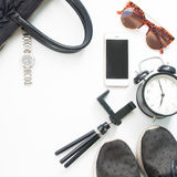Flat lay of woman accessories with cellphone and black color Stock Photo