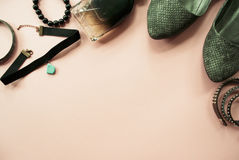 Flat lay of woman accessories on a pale pink pastel background. Place for your design, text, etc Stock Photography