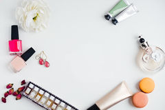 Flat lay of woman`s fashion beauty products on a white backgroun Royalty Free Stock Image
