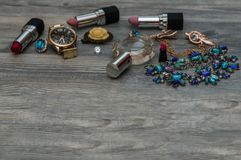 Flat lay of woman`s party accessories over the black background. Evening woman`s accessories and cosmetics. Flat design royalty free stock photography