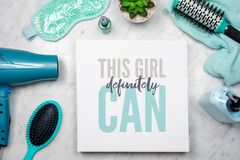 Flat lay of women`s beauty products with inspirational quote. That says `This girl definitely can` - empowerment concept royalty free stock photos