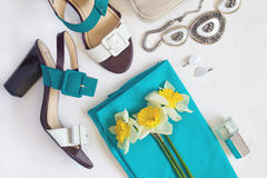Flat lay Women`s shoes and accessories collage. Beauty and fashi. On background. Top view with copy space. Toned Stock Photos
