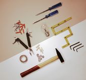 Flat lay - working tools and light bulb - solution concept Royalty Free Stock Photography