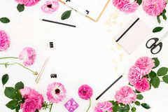Flat lay workspace with clipboard, pink flowers and accessories on white background. Flat lay, top view. Copy space. Flat lay workspace with clipboard, pink royalty free stock images