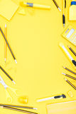 Flat lay of yellow office supplies, calculator and pencils with copy space Royalty Free Stock Image