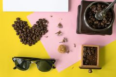 Flat layer heart smile icon shape ,sun glasses, vintage wooden coffee grinder. Top view flat layer heart smile icon shape ,sun glasses, vintage wooden coffee Stock Image