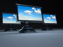 Flat lcd monitors. Three flat panel lcd computer monitors - 3d render royalty free illustration