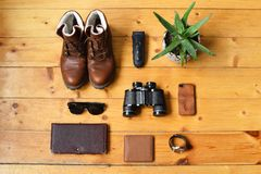 The flat lying top view, a set of men`s accessories on a wooden background. stock images