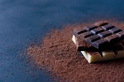 Flat with milk, black and white chocolate on a black background royalty free stock photo