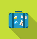 Flat modern icon of handle baggage with funky stickers and photo Stock Image