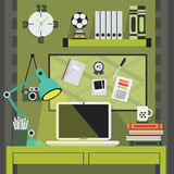 Flat, modern, and stylish green working place. Lamp, open laptop, ribbon bulletin board, soccer trophy, books, pencil case, hanging camera, and clock Royalty Free Stock Images