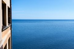 Flat near the sea with blue sky Royalty Free Stock Photo