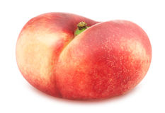 Flat nectarine isolated on white. Full depth of field. Stock Photo