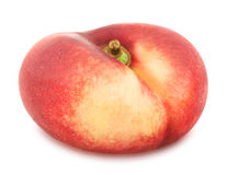 Flat nectarine isolated on white. Full depth of field. Royalty Free Stock Photography