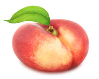 Flat nectarine with leaf. Full depth of field. Royalty Free Stock Photo