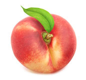 Flat nectarine with leaf. Full depth of field. Stock Photography