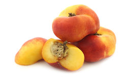 Flat nectarines and a cut one Stock Photo