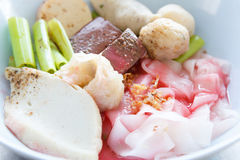 Flat noodles with fish ball in red sauce Royalty Free Stock Image