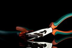 Flat nose and needle nose pliers. On black background Royalty Free Stock Images