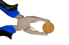 Flat-nose pliers and coin isolated. Royalty Free Stock Image