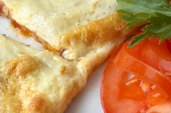 Flat omelet with tomato slice Stock Photo