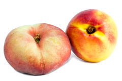 Flat peach and nectarine.Close up on a white background Stock Photo