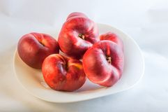 Flat peach on white plate Royalty Free Stock Image