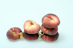 Flat peaches on light background Stock Photos