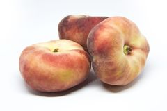 "Flat peach. Es and nectarines are known by several names. We call our es ""Saturn"" and our flat nectarines ""Saucer Stock Images"