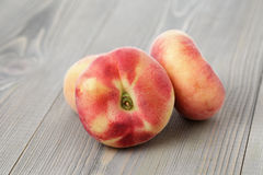 Flat peaches on wood table. Simple rustic style Stock Photography