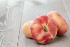 Flat peaches on wood table Royalty Free Stock Image