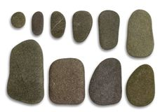 Flat pebbles arrangement. Two rows of graded flat pebble stones in light back Stock Image